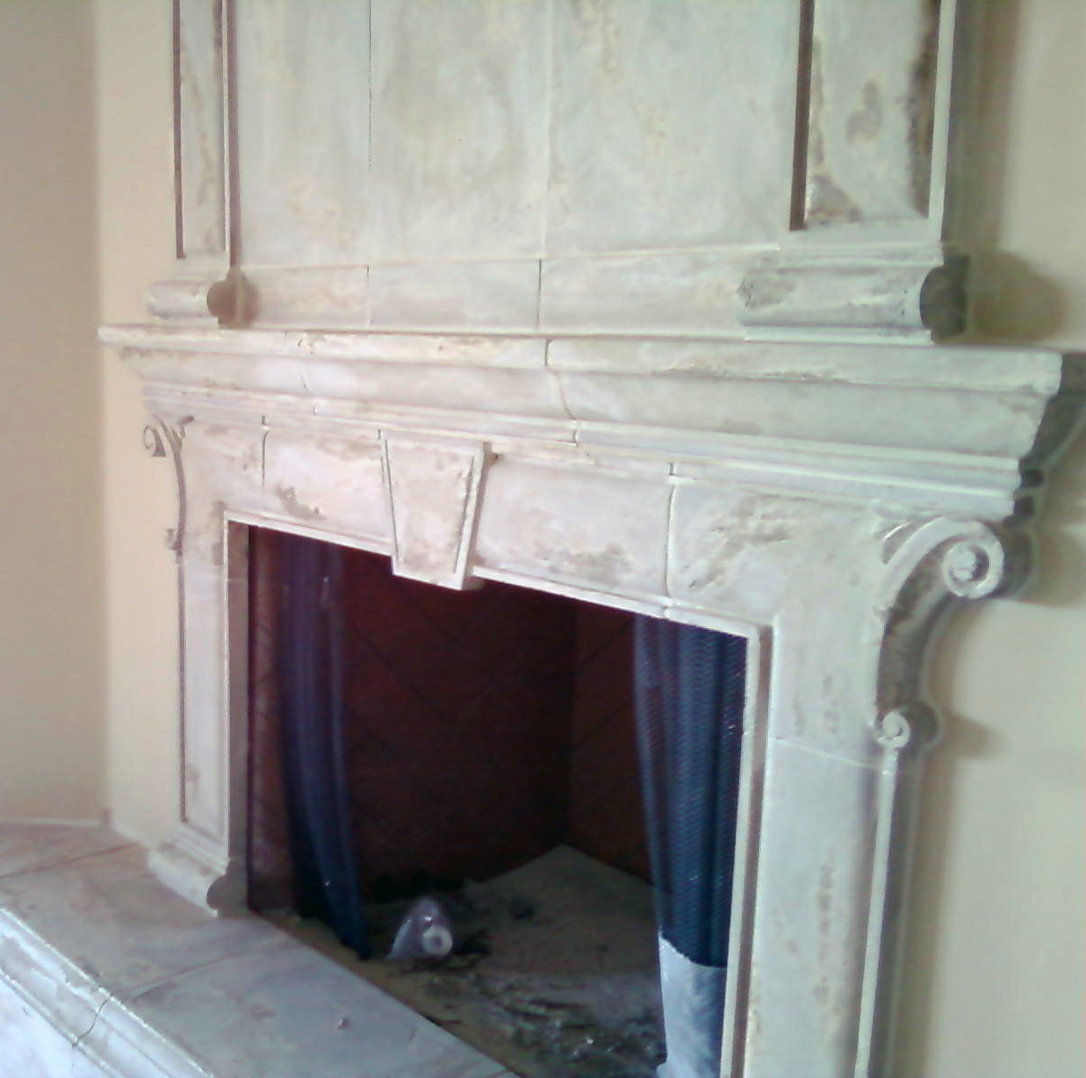 Handyman Finishes Professional Stone Fireplace