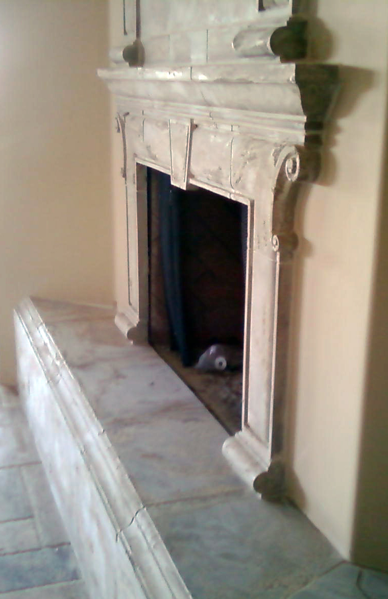Handyman Finishes Professional Stone Fireplace
